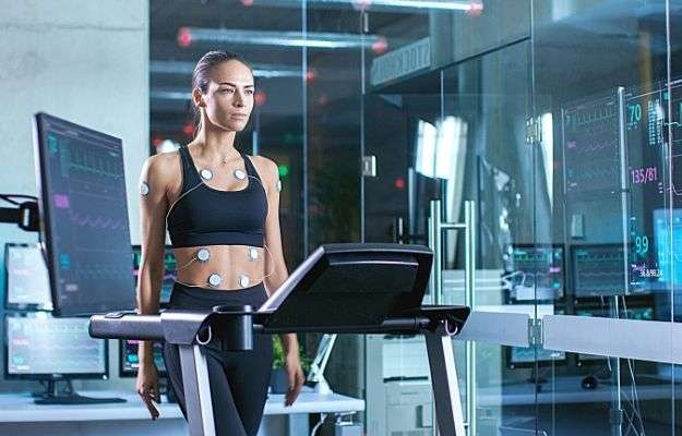 Beautiful Woman Athlete Wearing Sports Bra with Electrodes Attached to Her | Aside From Tracking Diet and Exercise, Does Data Tracking Have Other Healthcare Applications? | The Quantified Self: Why Your Personal Data Matters For Your Health